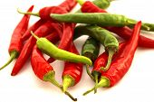 foto of chipotle chili  - isolated closeup of a pile of ripe red and green chili peppers