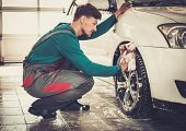 picture of alloys  - Man worker washing car - JPG
