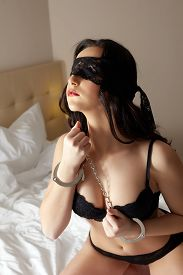 stock photo of handcuff  - Sensual blindfolded brunette in handcuffs - JPG