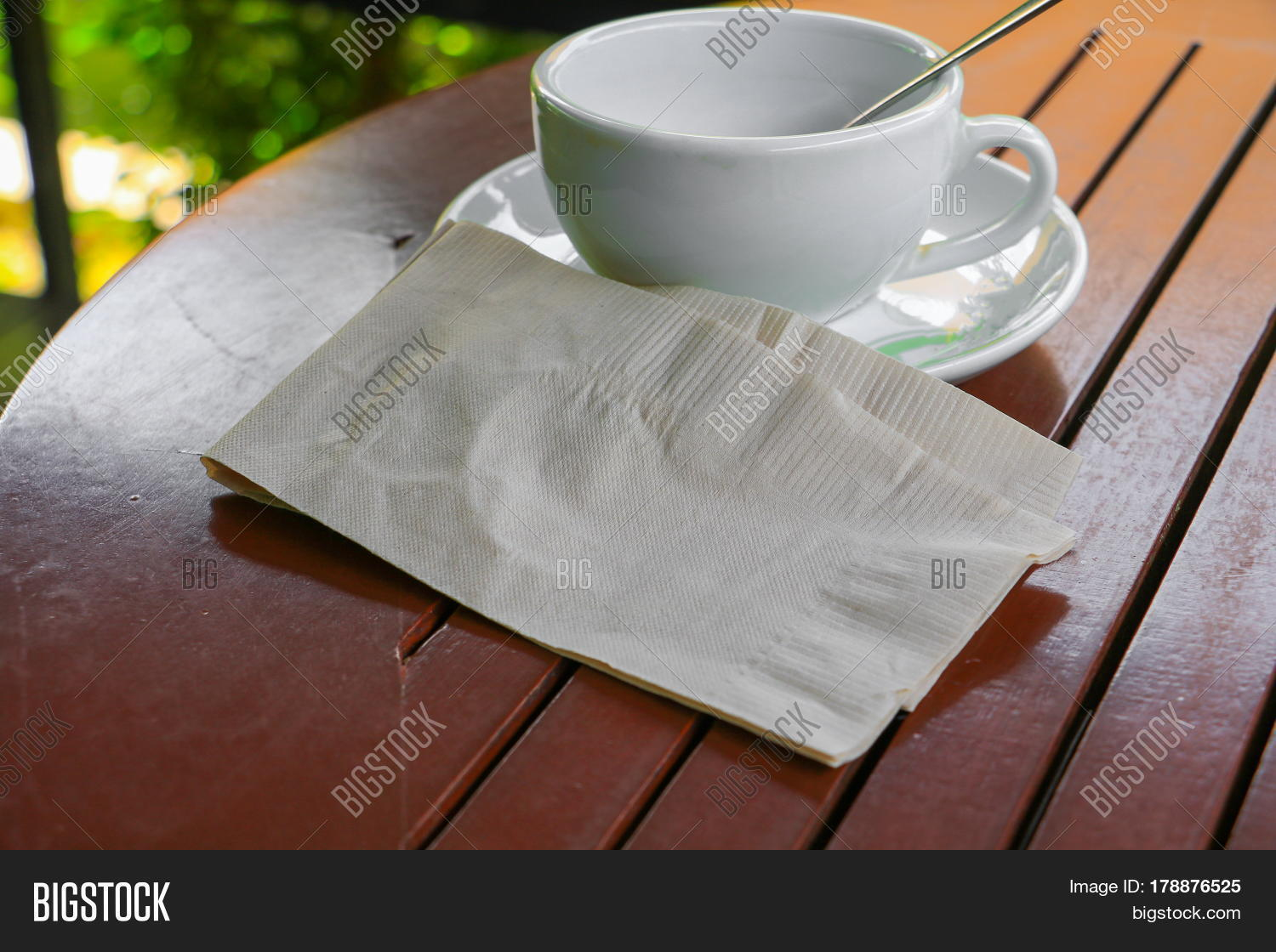 Napkin paper and coffee cup on table wood background for Shallow coffee table