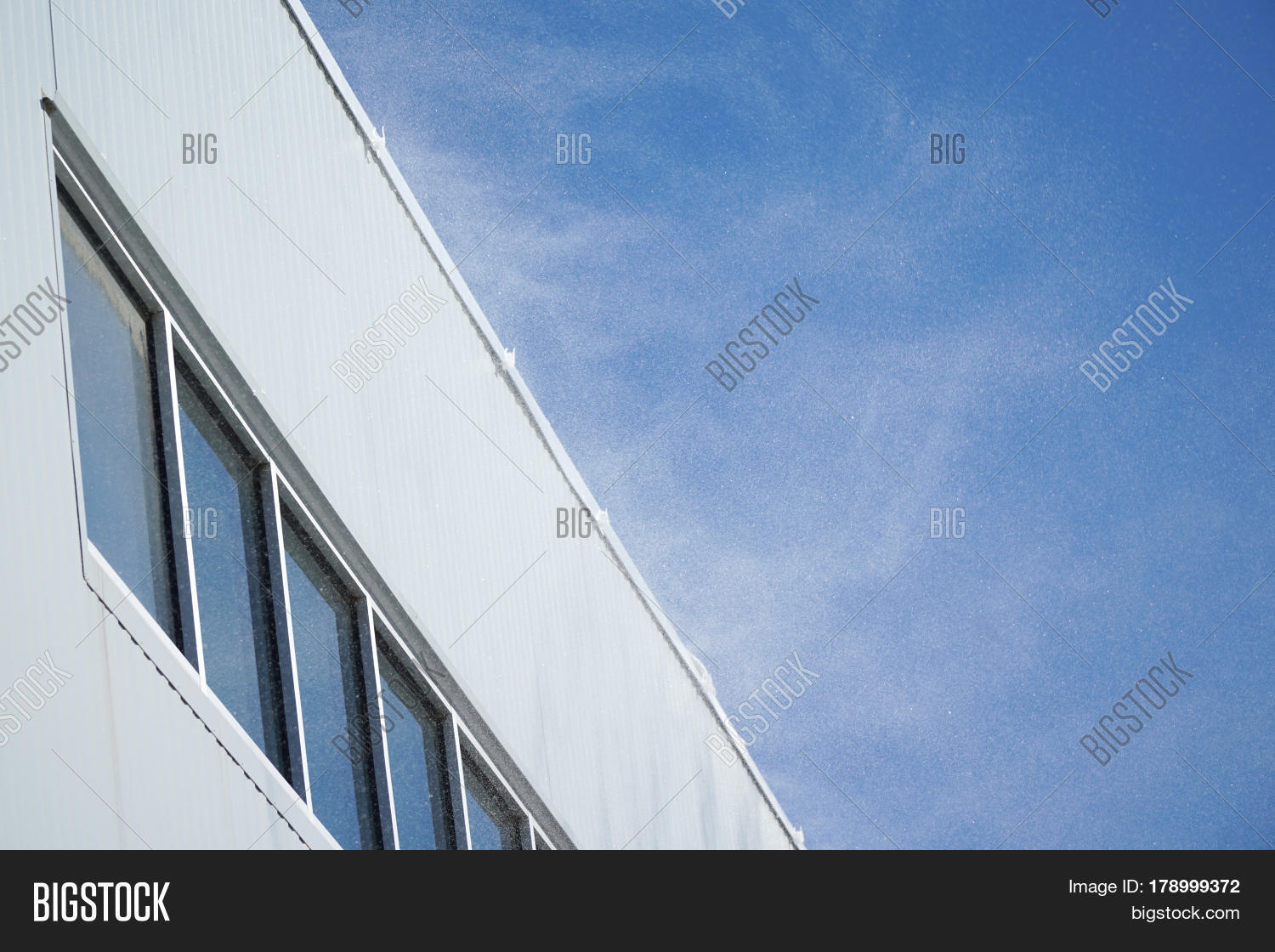 Wind Blowing On Building : Strong wind blowing snow building image photo bigstock