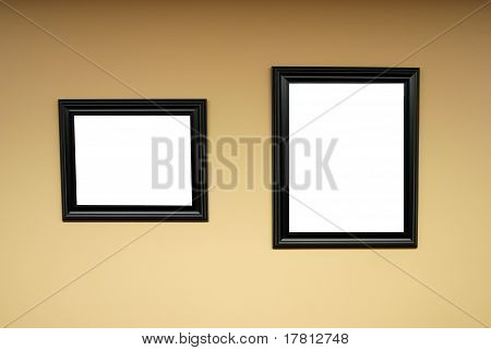 Blank Wooden Frames On Wall