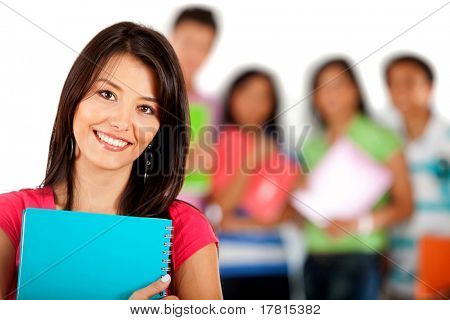 Female student smiling with a group behind her ? isolated