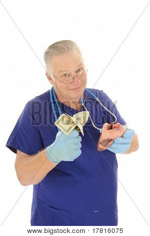 Doctor holding a fist full of money