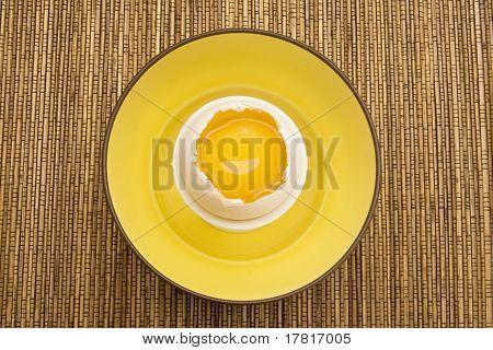 Yellow Egg Yolk In A Cracked Eggshell