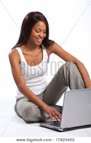 Beautiful black woman using laptop