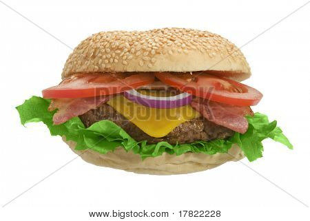 Cheeseburger with bacon, lettuce and onion on sesame seed bun