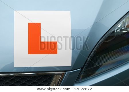 Red Learner Driver Symbol on a Car Hood with Blue Metallic Paint