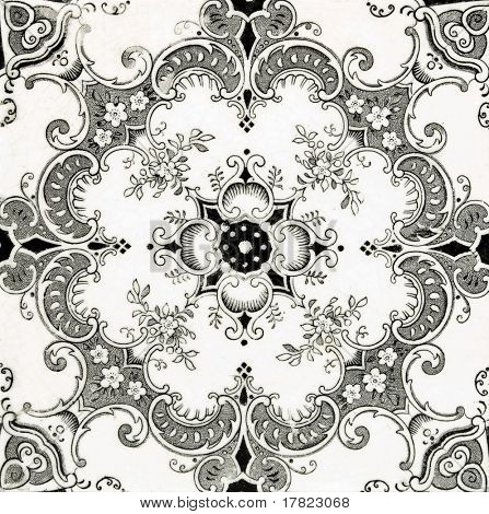 A Victorian black and white printed tile in the Aesthetic style