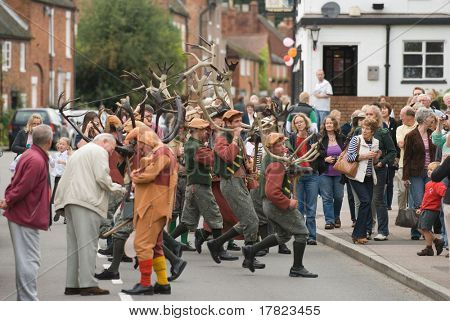 ABBOTS BROMLEY, STAFFORDSHIRE, UK - SEPTEMBER 8: Crowds Enjoy the Spectacle of the Abbots Bromley Horn Dancers Performing the Ancient Horn Dance, September 8 2008, Abbots Bromley, Staffordshire, UK