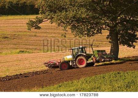 Tractor ploughing the field in autumn