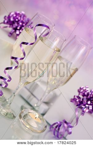 Champagne with gifts and candle set at an angle - purple theme