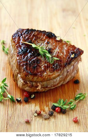 juicy sirloin beef with branches of thyme