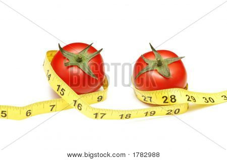 Tomatoes And Measuring Tape Illustrating Dieting Concept