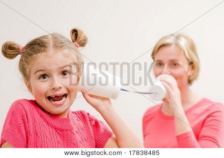 Communication - playing with mug phone