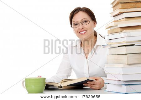 Mature student woman is learning at the desk