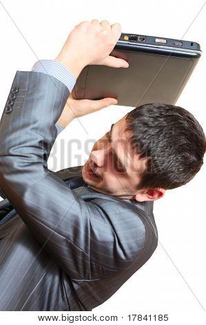 Business Man In Stress Throws Laptop