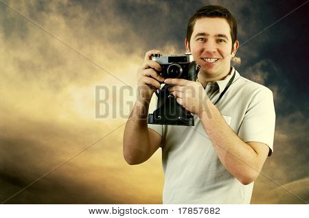 Happiness man with vintage photo camera