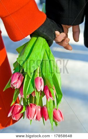Loving pair with bouquet of tulip