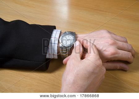 Businessman hands and wristwatch