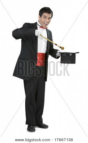 Magician holding a magic wand and a hat over white background