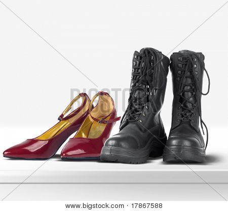 Lady red shoes and military boots isolated on white background