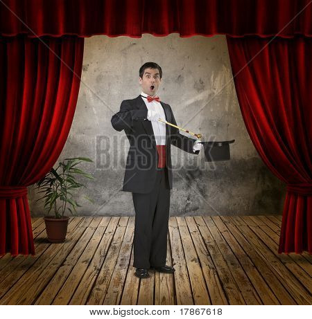 A funny magician on stage