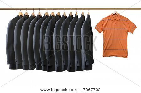 Grey jackets and an orange t-shirt hanging on coat hangers isolated