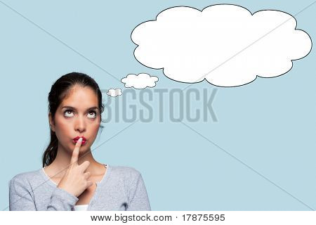 Photo of a woman with a thoughtful expression, thought bubbles to add your own text or image.