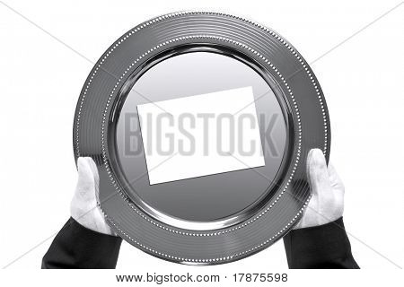 Photo of a silver tray with blank card on being held by a butler, shot from above and isolated on a white background.
