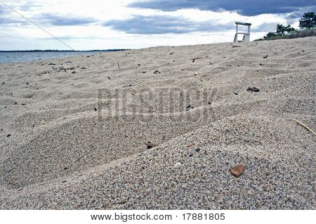 Fine beach sand with lifeguard stand