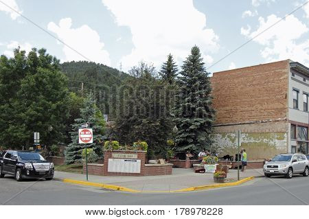 Idaho Springs CO USA - June 24 2016: In downtown Citizens Park some musicians played instruments on a summer day. People play music in downtown Citizens Park.