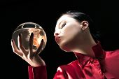 picture of hand kiss  - girl is holding and looking a gold fish - JPG