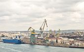 stock photo of shipbuilding  - Powerful shipbuilding shipyard with a pier and cranes - JPG