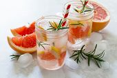 Refreshing Summer Drink With Grapefruit And Rosemary On A Stone Background. The Concept Of Eating Ve poster
