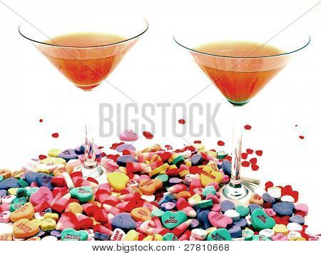 Candy Sweethearts and heart shaped Red Hots spilled across the base of Cosmopolitan Martinins