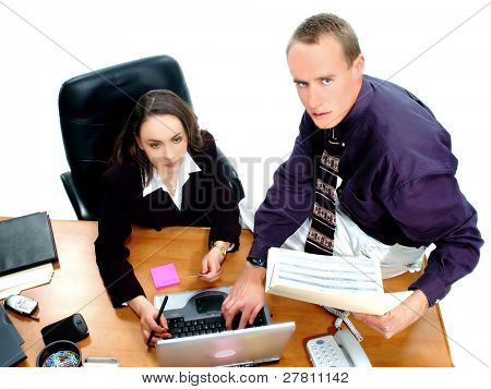 Businessman and businesswoman making a credit card purchase online