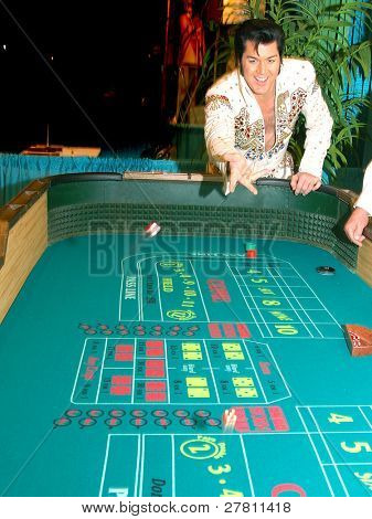 The King, Elvis Presley impersonator playing craps in Las Vegas with dice in the air
