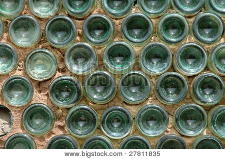 Architectural detail of a wall built of adobe and sasperilla bottles