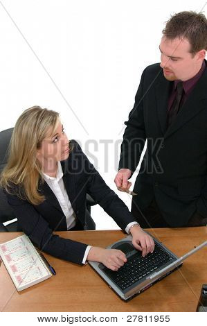 Business man and woman shopping via the INTERNET
