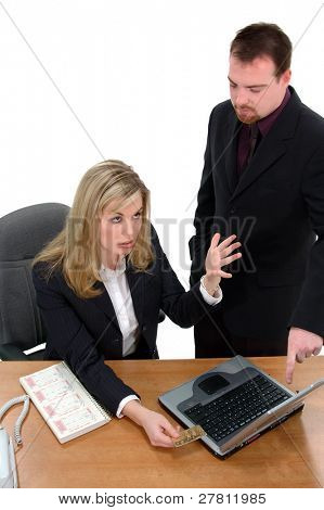 Business man and woman shopping via the INTERNET and having their credit card denied