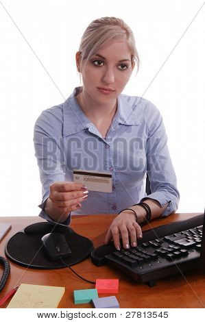 A corporate office worker making an on line purchase with a credit card.