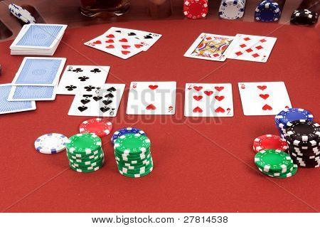 A hand of Texas Holdum laid out on a casino table Card backs are a digitally created design