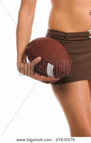 Sexy woman in a bikini, holding a football Bikini by Swim Bay