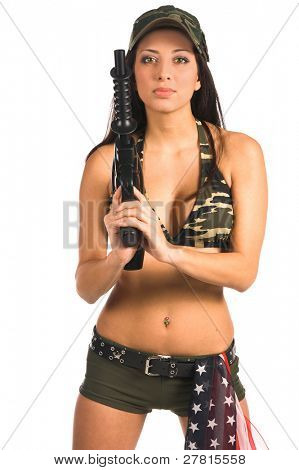 Beautiful latina woman in military camouflage with a paint ball gun and an American flag