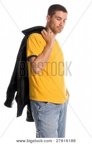 Handsome young  man in a yellow t-shirt, jeans and a leather jacket