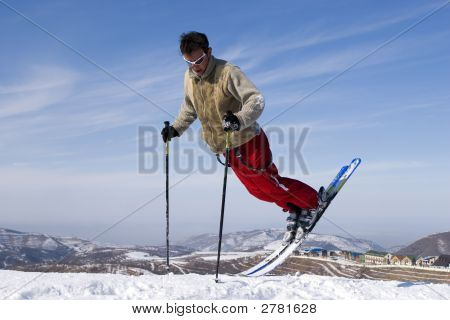 Snow Skier Jumping Against Blue Sky