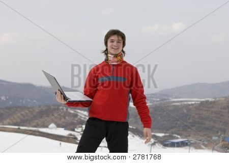 Happy Teens Student With Laptop In Hand In Winter Mountains Tien Shan Over Sky