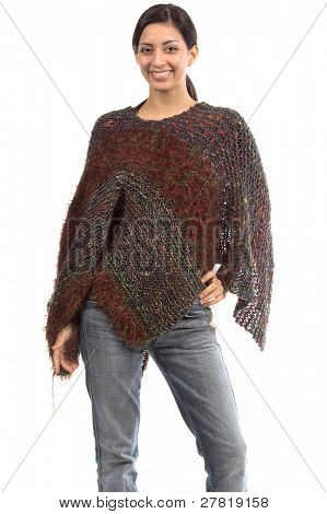 Beautiful young Mexican woman in a couture poncho / shawl of multicolored yarns