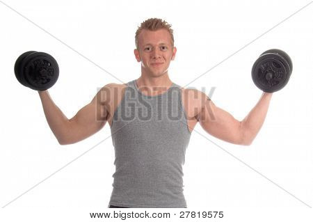 Young man working out in the gym curling 20 pound free weights